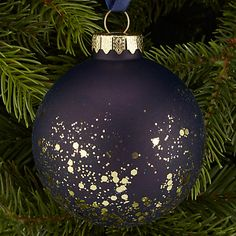 Interior Inspiration - Blue Christmas | Create elegant festive decor with a palette of deep navy and indigo. This navy bauble looks amazing adorned with gold glitter #theloungeco #christmas #bluechristmas #decor #decoration #blue #interiorinspiration #indigo #navy #dark #gold