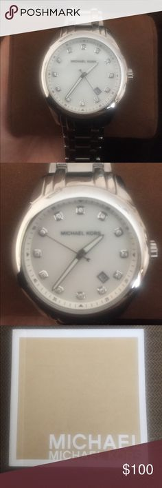 Silver Michael Kors Watch Silver chain link MK watch, great condition only worn 3 times, white marble face with diamonds as time symbols, comes with extra links to make it bigger/smaller, comes in box Michael Kors Accessories Watches