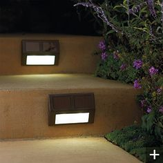 Set of Four Solar Wedge Lights | Without the hassle of hardwiring, our Solar Wedge Lights can add extra illumination to outdoor steps, railings, or docks that would otherwise be unsafe at night. The light's wedge shape angles up to 8 hours of light downward onto steps or walkways.