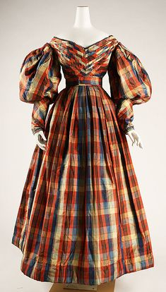 I feel like my alt.heimers is kicking in on this one, but I love the loud plaid and it would be a marvy 1950's dress if you took off those awful sleeves! Plaid silk dress, British, ca. 1830.