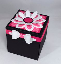 """""""This 3D pink and black floral birthday explosion box card is sure to please the recipient. A 'box' made from 110 lb shimmer black card stock, decorated with a 3d paper flower and bow. Take the lid off the box and the sides of the box fall down, to reveal a happy birthday, more flowers and a heart on which silver numbers proclaim the recipients age. The box comes fully assembled and stands approx 4\"""" x 4\"""" x 4\""""."""" Diy Crafts For Girls, Diy And Crafts, Birthday Explosion Box, Exploding Gift Box, Gift Wrapping Techniques, Valentines Gift Box, Cool Paper Crafts, Birthday Cards, Diy Birthday"""