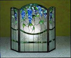 stylish and modern stained glass fireplace screen design for our warmth: curve stained glass firepace screen with upper side blue green leave patterns Stained Glass Rose, Tiffany Stained Glass, Stained Glass Lamps, Stained Glass Designs, Stained Glass Panels, Stained Glass Projects, Stained Glass Patterns, Leaded Glass, Mosaic Glass