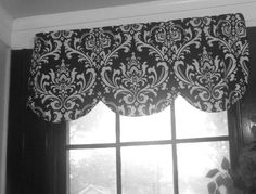 Set of cafe kitchen curtains with scallop valance 42 x 16 inches,  plus 2 panels 26w x 36L black and white damask. $80.00, via Etsy.