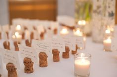 Champagne corks as place card holders.