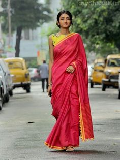 Gaurang Shah's pink saree with a  yellow and green floral blouse. Simple and elegant.