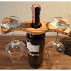 Brilliant at a picnic, the Pomegranate Solutions Swivel Wine Glass Holder is supported by your wine bottle and holds two wine glasses at the ready. Wine Glass Holder, Wine Bottle Holders, Pallet Wine Holders, Wooden Wine Holder, Box Wine, Electric Wine Opener, Wood Wine Racks, Wine Decor, Diy Bottle