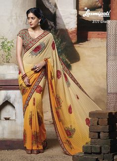 Printed blouse piece & lace are provide GRACY look to the lining & floral printed orange-white saree.
