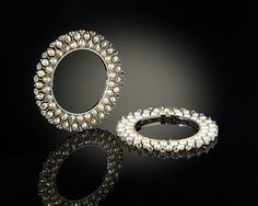 Bhagat pearl and diamond bracelets from the Al-Thani collection exhibited at the Met. Absolutely love these.