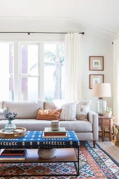 Mixing patterns with the rug, coffee table, and pillow.