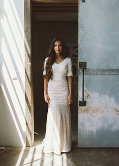 Modest Wedding Dresses - Novelty lace trumpet gown with lined and scalloped elbow-length sleeves, scalloped V-neckline, dropped waistline, back covered buttons cascade down to hemline and sweep train. 70s Wedding Dress, Wedding Dresses Lds, Mon Cheri Wedding Dresses, Stunning Wedding Dresses, Wedding Dress Sleeves, Temple Dress, Lace Bride, Cheap Dresses, Bridal Gowns