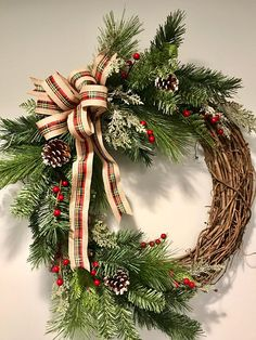 Winter Holiday Christmas Pine Wreath with Burlap Bow. Includes Winter Greens, Snow Branches, Berries, Pinecones, and Burlap and Plaid Bow. Great for Front Door, Wall, or Anywhere. Use All Winter. Great Housewarming Gift! designed on 18 in Grapevine Base.