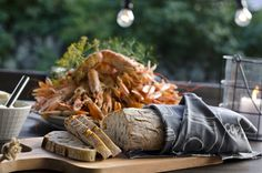 Freshly baked bread on a rustic cuttingboard - a perfect complement to the crayfish. #lagerhaus #2014 #kräftskiva #kitchen