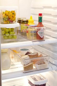 use plastic bins to compartmentalize your fridge