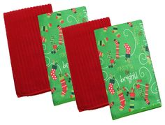 """Two of the towels have a background of Christmas green and are printed with holiday stockings and the words """"merry and bright."""" #christmaskitchentowel"""