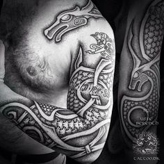 Sleeve inspired by the carved animals from the keel of the Oseberg ship. By @uffeberenth (text and smaller beasts are older tattoos)
