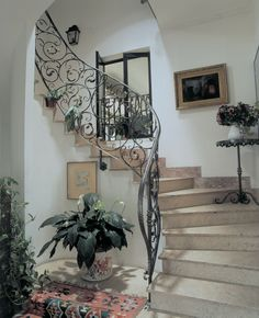 Few decorative flourishes are as striking as a well executed wrought iron stair railing.  Here you can see our 94/C/12 and 94/E/3 pieces used to great effect. http://www.indital.com/Scroll-W-Forged-Leaves-14-9-16-X-13-X-1-2-Dia-p/94-c-12.htm