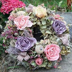 Dusky pink wreath decorated with dry hortense flowers, fabric, small shells and tiny lace bows.