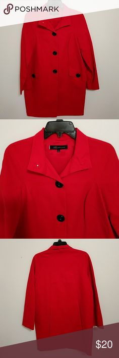 Anne Klein red spring coat This beautiful coat has big black buttons that snap on in the front. It has to Side Pockets with buttons for closure. Anne Klein Jackets & Coats