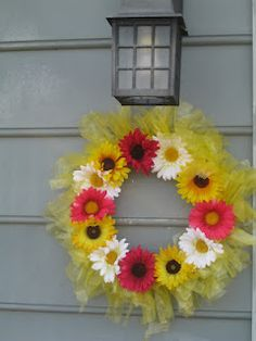 Outdoor wreath using plastic bags. Hmmm... could use plastic tablecloths from dollar store to get a more suitable color.