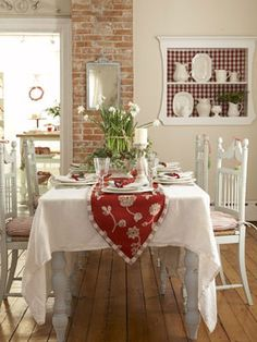 Dine in a Swedish-inspired wonderland! Remove rugs to expose mellow floors. Sew seat cushions of affordable red-and-white ticking fabric and lay a crisp white flea-market tablecloth.