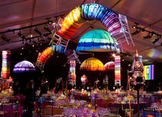 Umbrellas made from brightly colored tablecloths and twisted stacks of seat cushions- National Design Awards