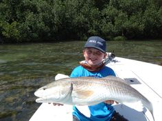 Tyler with his biggest Redfish to date!