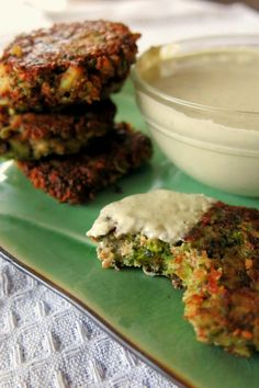 BROCCOLI FRITTERS: [2 medium heads of broccoli,   ¼ cup minced Anaheim chile pepper,   2-3 cloves minced garlic,  1½ teaspoons lemon juice,   ¼ teaspoon sea salt,   ½ cup unsalted almond butter,  2 tablespoons cooking oil for frying.   Use another sauce, this one is cashew based, with lemon and tarragon]