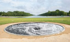 Anish Kapoor's latest exhibition at the Palace of Versailles explores controversy and hedonism. The collection of six works are dotted across the Chateau's gardens and nearby Salle du Jeu de Paume. Pictured here: 'Descension,' 2014