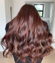 Stylists and colorists on Instagram are sharing photos of what they're calling strawberry brunette or strawberry brown hair, the brunette counterpart to strawberry blonde hair that serves as a way to add reddish-pink highlights to brown hair.