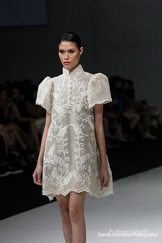 "In the Philippines men wear a traditional clothing piece called a ""barong"" which is worn at special occasions. Here it's incorporated in women's fashion breaking that gender barrier. Modern Filipiniana Gown, Filipiniana Wedding, Barong Tagalog For Women, Barong Tagalog Wedding, Grad Dresses, Wedding Dresses, Filipino Wedding, Filipino Fashion, Philippines Fashion"