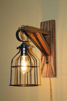 Edison Wall Mounted Lamp with black metal Cage- Winding Run Creations-etsy Sale price-$70