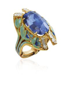 AN ART NOUVEAU SAPPHIRE, ENAMEL AND DIAMOND RING, BY RENÉ LALIQUE. Centering an oval-cut sapphire to the openwork surround and hoop depicting poppy flowers in green and blue enamel, with diamond accents, circa 1900, ring size 3 ½, mounted in gold. Signée Lalique. SSEF / the origin of the sapphire is Ceylon (Sri Lanka), with no indications of heating. #RenéLalique #ArtNouveau #Jewelry #Jewellery #BijouxArtNouveau