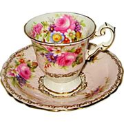 Early Foley teacup duo c1900. Bouquets of tulips, roses and other pretty flowers, golden filigree and soft pink band, with an embossed saucer and foot.