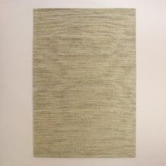 Handcrafted of jute with a flatweave construction, our natural fiber area rug features a sophisticated medley of shades ranging from light indigo denim to medium blue-gray. Each exclusive, hand-dyed rug displays variations in color saturation, giving every piece a unique blend of hues.