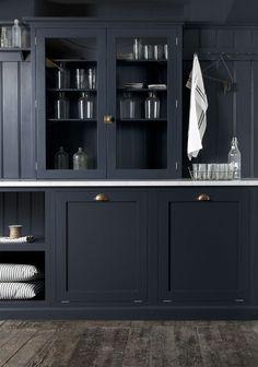 Contrasting counter top and dark floor.