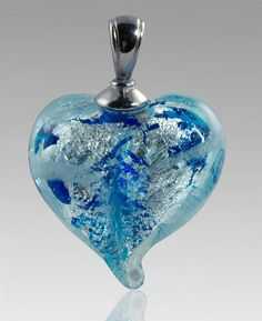 These exquisite glass cremation pendants are custom made in the color of your choice and encase a small portion of your loved…