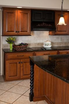 "Refaced Kitchen Cabinets: Victorian Antique ""Honey"" finish with hand applied ""Warm Brown"" glaze over hardwood sugar maple. Turnings and accents finished in Old World ""Antique Slate""."
