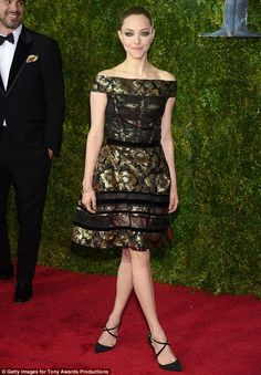 Golden girl: Amanda Seyfried glowed in an off-the-shoulder black and gold gown as she atte...