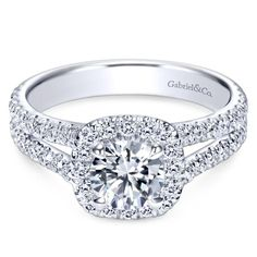 This exceptional Gabriel & Co. setting includes a sparkly halo that encircles the center stone for a spectacular look, while two rows of pavé diamonds shine on its contemporary split shank band. * Setting only - center diamond sold separately Round Halo Engagement Rings, Engagement Rings Cushion, Classic Engagement Rings, Engagement Ring Styles, Diamond Wedding Rings, Women Wedding Rings, Best Wedding Rings, Wedding Ring Designs, Wedding Ideas