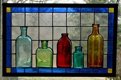 Stained glass panel with antique bottles-love the mixed levels of glass, will have to try with some modifications, of course