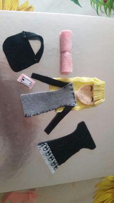 Handmade felt doll with accessories