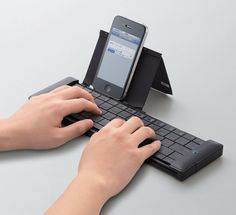 Elecom's Retractable Wireless Keyboard. For smartphone or tablet, in black or white.