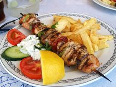 For a great, Greek dish straight from the grill, why not try a fantastic pork souvlaki? It's small pieces of marinated pork grilled on a skewer served with pita and tzatziki sauce. Grilling Recipes, Pork Recipes, Chicken Recipes, Cooking Recipes, Healthy Recipes, Recipies, Cooking Games, Ribs, Greek Dishes