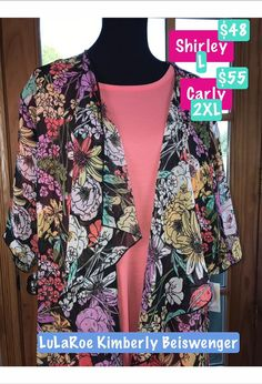 Pink, blue, yellow, and purple floral LulaRoe Shirley paired with a solid rose pink LulaRoe Carly dress. Beautiful Lularoe outfits make wonderful holiday gifts, or great additions to your own Lularoe collection. Join our group to shop all our Lularoe styles and sizes. http://facebook.com/groups/twodaughtersandamom/