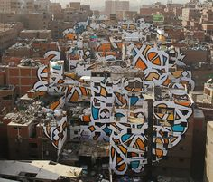 'Calligraffiti' artist el Seed worked with the ward to develop an incredible mural spanning 50 buildings, aiming to change perceptions and raise awareness about the community.