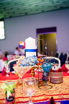 another table decor, we hemmed it up with beautiful mediterranean lanterns and candles! colourful saree looking material used for the table cloth!