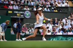 Agnieszka Radwanska hits out during her semi-final win. - Matthias Hangst/AELTC