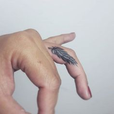 small-feather-finger-tattoos-women-designs-ink-art