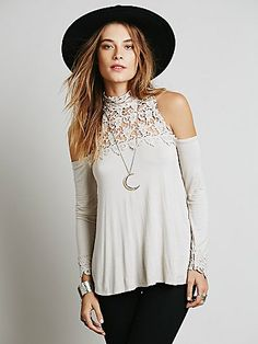 This long sleeve, swingy cold shoulder top features a Victorian inspired neckline in tonal lace with button closures up the back and lace cuffs.  *FP X- From Free People, with love. Inspired by finding beauty in vintage details, embroidery, lace, and heirloom embellishment.