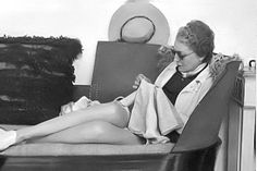 Mona Williams Bismarck working on needlepoint in Palm Beach in 1937.